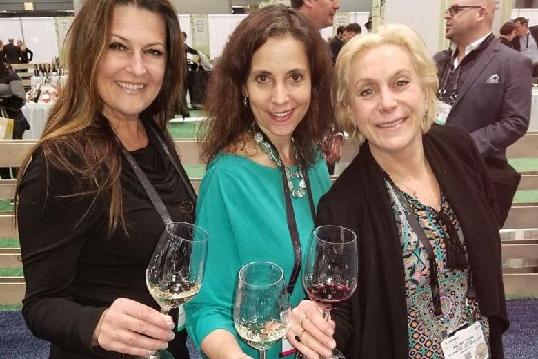 Three Women with Wine